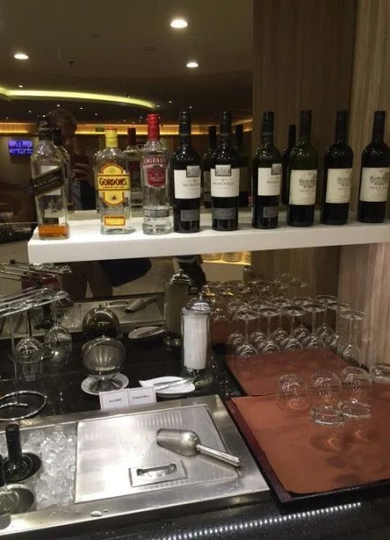 The limited self-serve bar in side the T1 SATS Lounge.