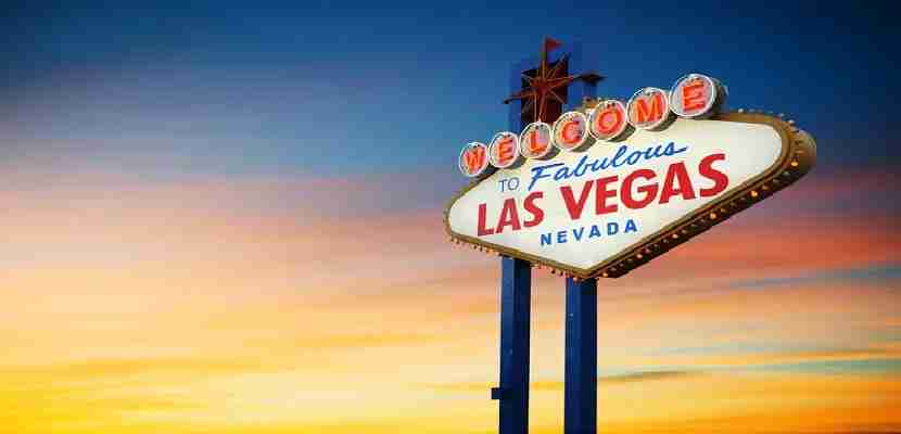 Visit the Las Vegas sign at sunset. Image courtesy of Shutterstock.