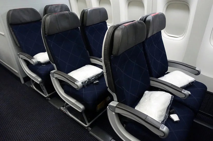 The three two-seat rows at the back of AA's 773 cabin.