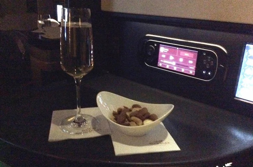Champagne and warm nuts to start off meal service.