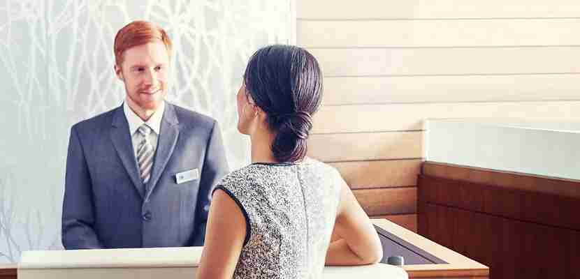 Marriott front desk check-in staff featured