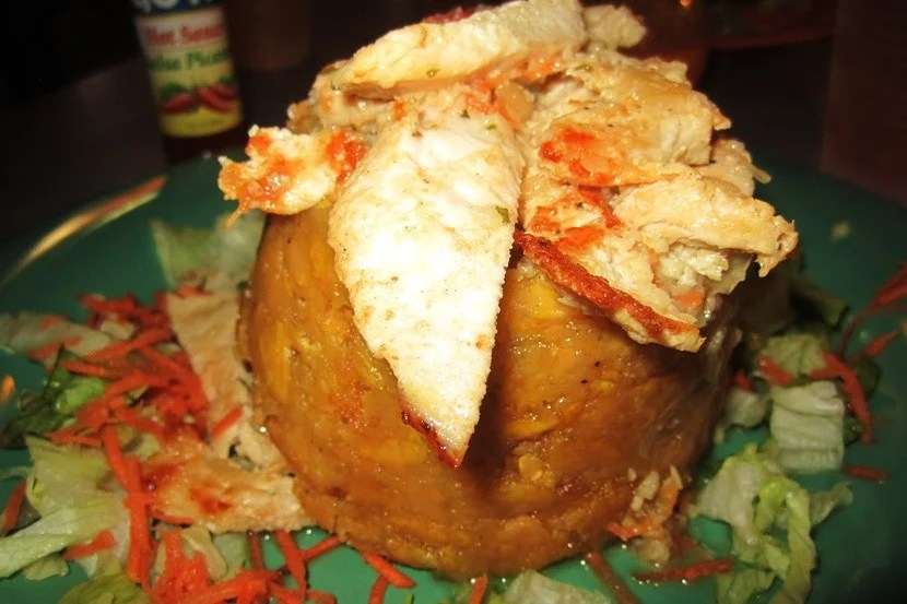 <em>Mofongo</em> topped and filled with garlic chicken.