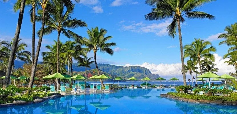 Use the Starpoints you earn from these cards' sign-up bonuses to stay at properties across the globe, like the St. Regis Princeville. Photo courtesy of Starwood.