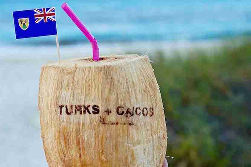 Sipping cocktails from a coconut is an absolute must in Turks & Caicos.