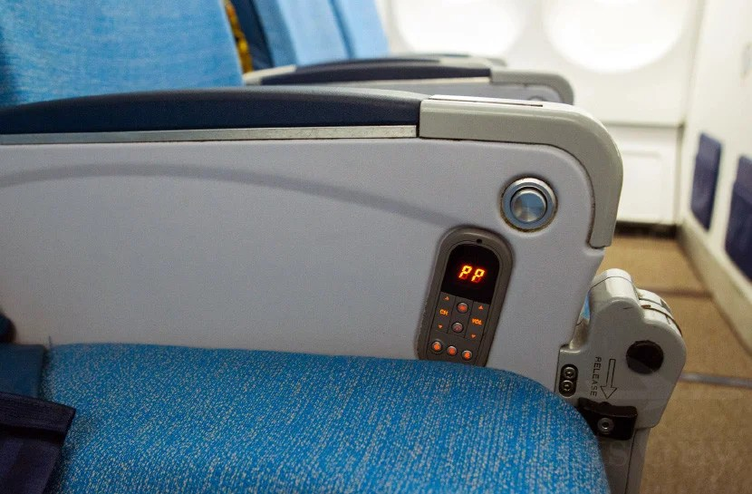 A small entertainment control is fixed to the seat.