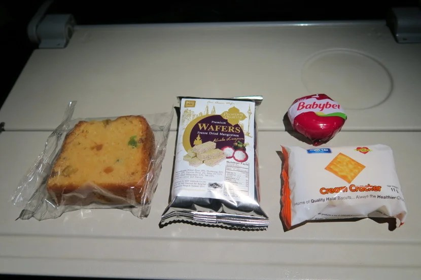 Instead of a self-serve snack area in the galley, each passenger received a box of snacks in the middle of the flight.