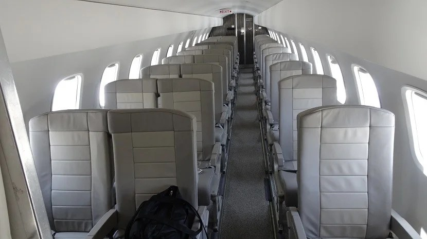 The Embraer E135 was configured with 30 leather seats in a 2x1 arrangement — and no overhead bins.