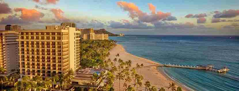 Save on an upcoming stay at Hilton - such as at the Hilton Hawaiian Village in Waikiki. Image courtesy of Hilton.