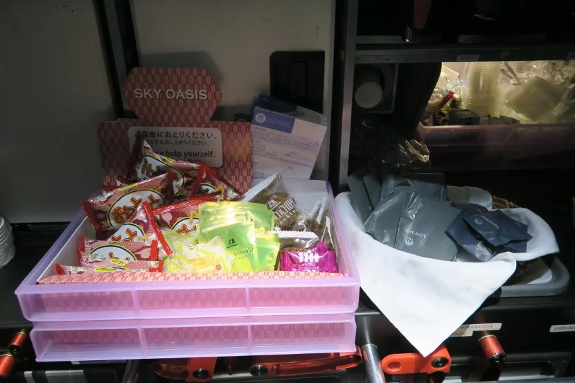 """The """"Sky Oasis"""" snack box had plenty of snacks for those who were awake, while the basket next to it had eye masks and ear plugs to aid sleeping."""