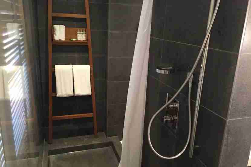 The shower was unnecessarily long and narrow.