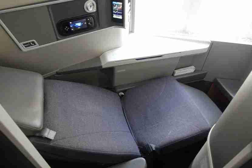 American Airlines lie-flat B772 reverse herringbone seats by Zodiac.