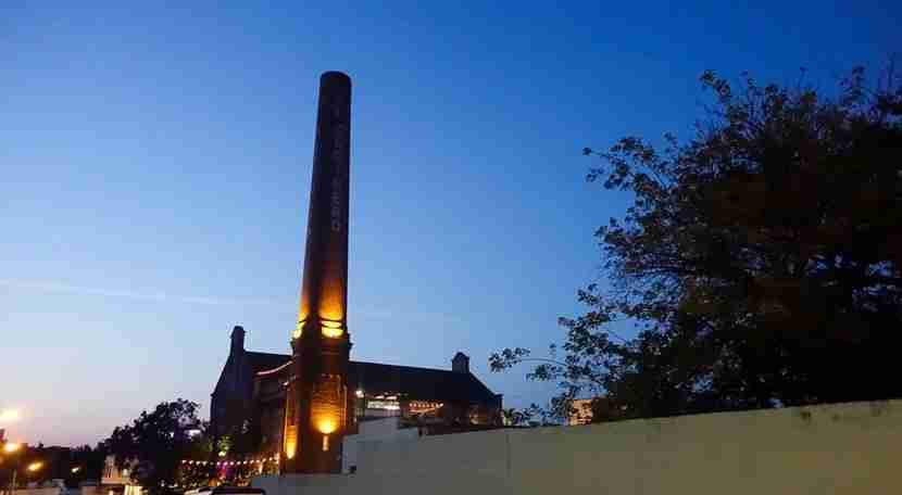 El Cocinero and its signature smokestack,dating back to its days as a factory.