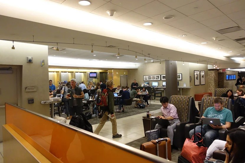 A crowded Admirals Club near gate 42 still offers complementary snacks, as well as a variety of drinks.