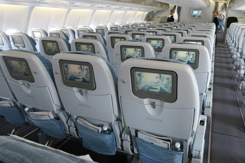 Each seat back featured a bright IFE screen.