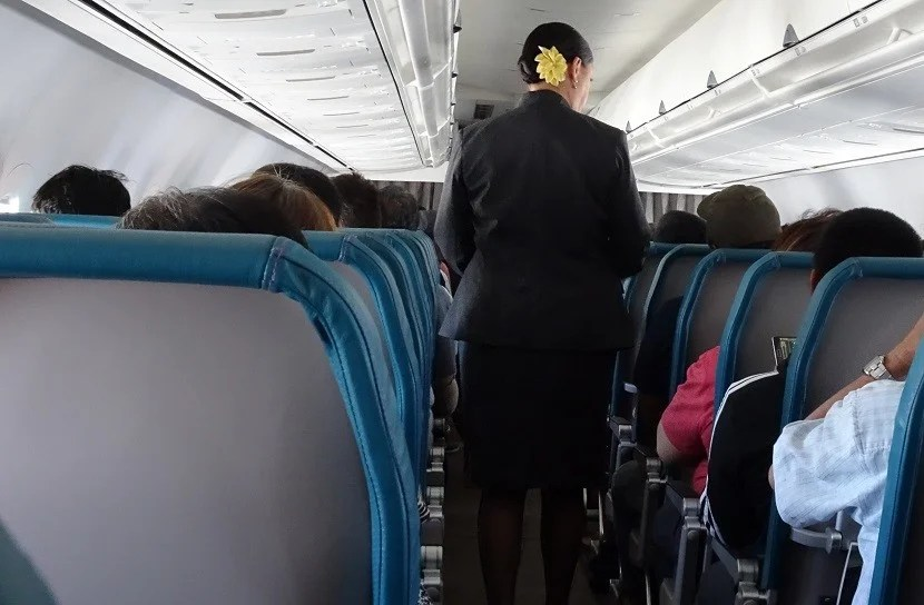 Even from behind, you can tell a Hawaiian Airlines flight attendant by the flower in her hair.