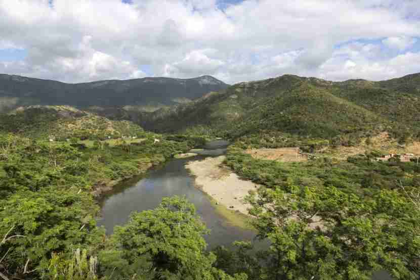 """Baconao Park and Biosphere Reserve is a beautiful, protected area located just outside Santiago de Cuba. Photo courtesy of <a href=""""http://www.shutterstock.com/dl2_lim.mhtml?src=xkXOzUqtcQ38MibMy8_4WA-1-1&amp;clicksrc=download_btn_inline&amp;id=377096026&amp;size=medium_jpg&amp;submit_jpg="""" target=""""_blank"""">Shutterstock</a>."""