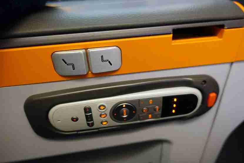 The seat adjustment buttons were located on the armrest, along with the IFE remote.