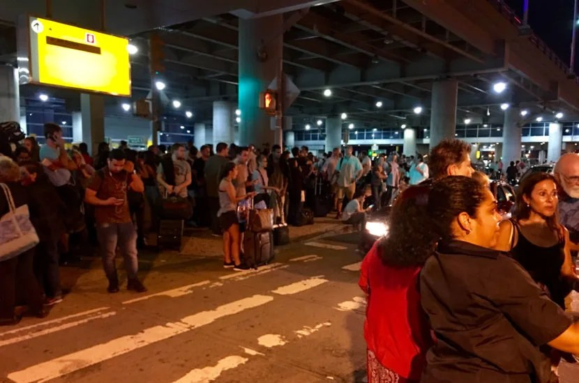 After evacuating, passengers congregated outside the terminal.