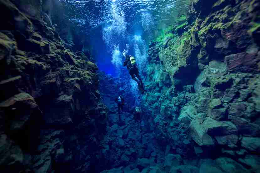 "Snorkel the Silfra fissure, just one hour from Reykjavik. Photo courtesy of <a href=""http://www.shutterstock.com/pic-299902592/stock-photo-silfra-iceland.html?src=tI62Rfkptw3IdE4vj0NFLQ-1-14"">Shutterstock</a>."
