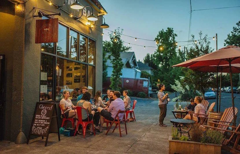 """Taste the wines of Oregon right in the heart of Portland. Image courtesy of Southeast Wine Collective's <a href=""""https://www.facebook.com/SeWineCollective/photos/a.1067857499914427.1073741830.449241631776020/1264950656871776/?type=3&theater"""">Facebook page</a>."""