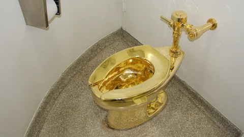 People Wait Hours to See This Solid Gold Toilet in NYC