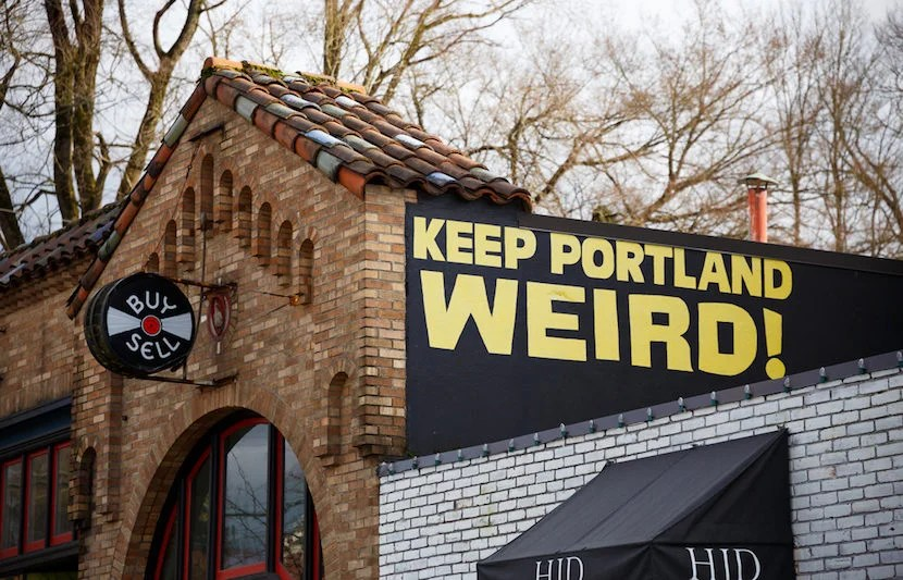 """Portlanders have lots of idea as to how to """"Keep Portland Weird."""" Image courtesy of <a href=""""http://www.shutterstock.com/pic-373912246/stock-photo-portland-or-february-2-2016-keep-porltland-weird-sign-at-a-well-known-record-store-in-downtown-pdx.html?src=8DDBeR4B7Lf1NXVhqkAFMg-1-0"""">Shutterstock</a>."""