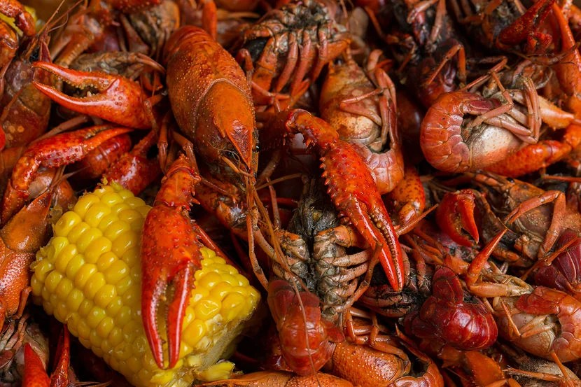 """Spring in New Orleans means it's time to dig into some crawfish. Image courtesy of <a href=""""https://www.shutterstock.com/pic-407492227"""" target=""""_blank"""">Shutterstock</a>."""