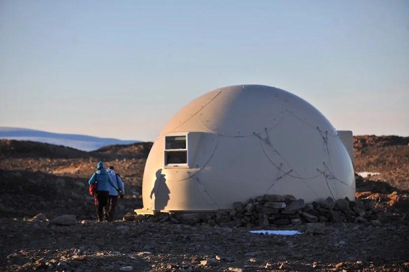 Appropriately, White Desert's fiberglass sleeping pods look like igloos. Image courtesy of White Desert Antarctica.