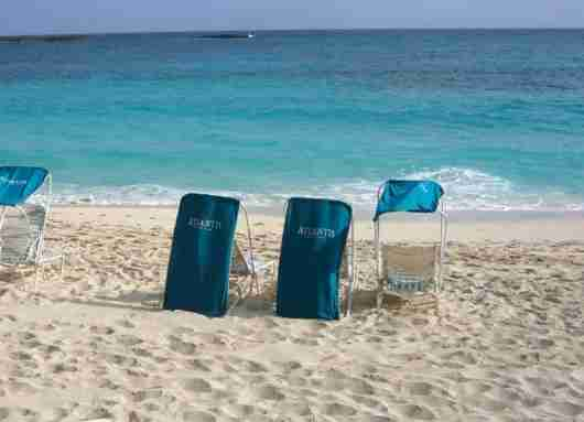 The covered chairs are great when the sun is shining on the beach.
