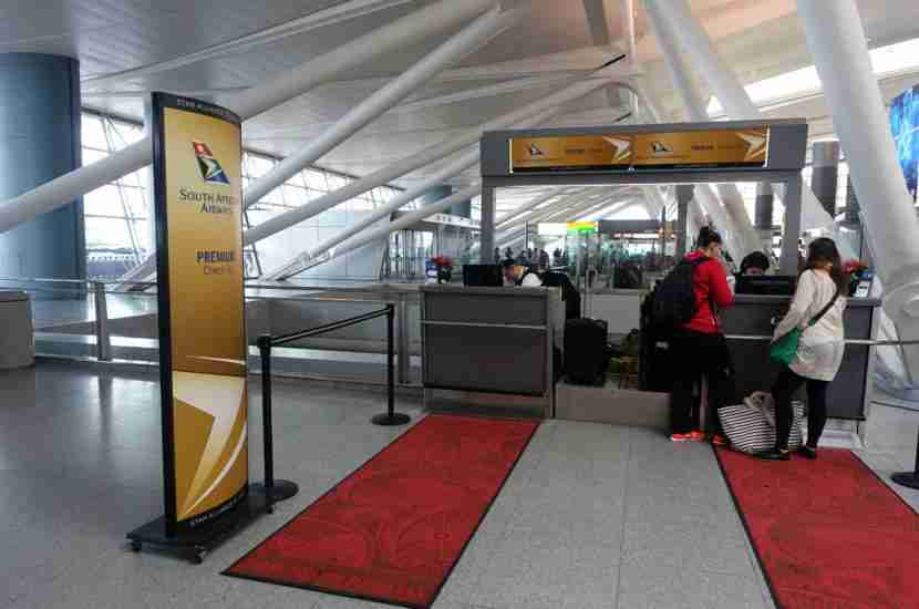 The premium passenger check-in counter was located off to the side, closest to the main doors of the terminal.