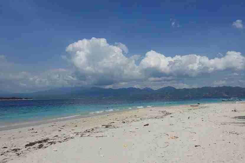A deserted beach on Gili Meno with views of Lombok. Photo by Lori Zaino.