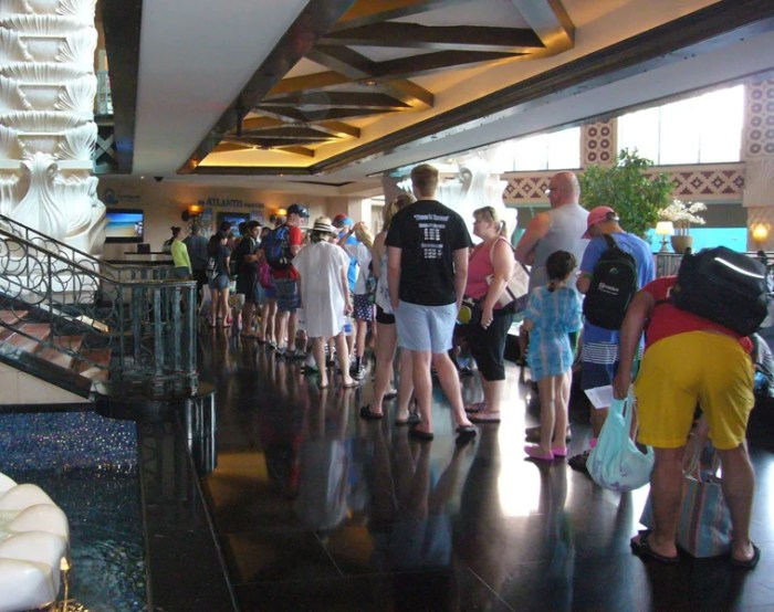 Get there early or wait in a long line to get a wrist band before you can roam around Atlantis.