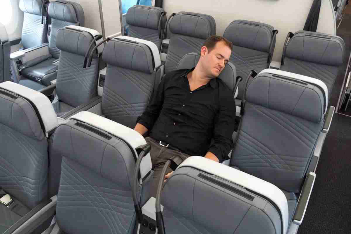 TPG dozes off in premium economy during a tour of the new Singapore Airlines A350.