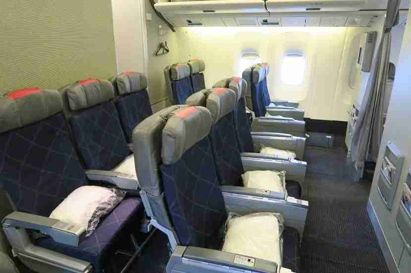 Rows 12 and 13 make up a mini-cabin of Main Cabin Extra seating.