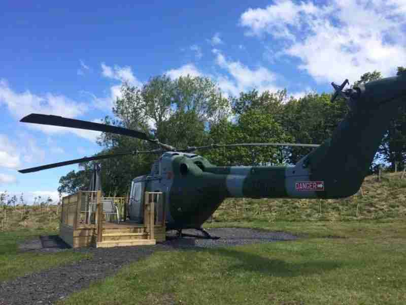 Enjoy a glass of wine on the helicopter patio. Image courtesy of Ream Hills Caravan Park.