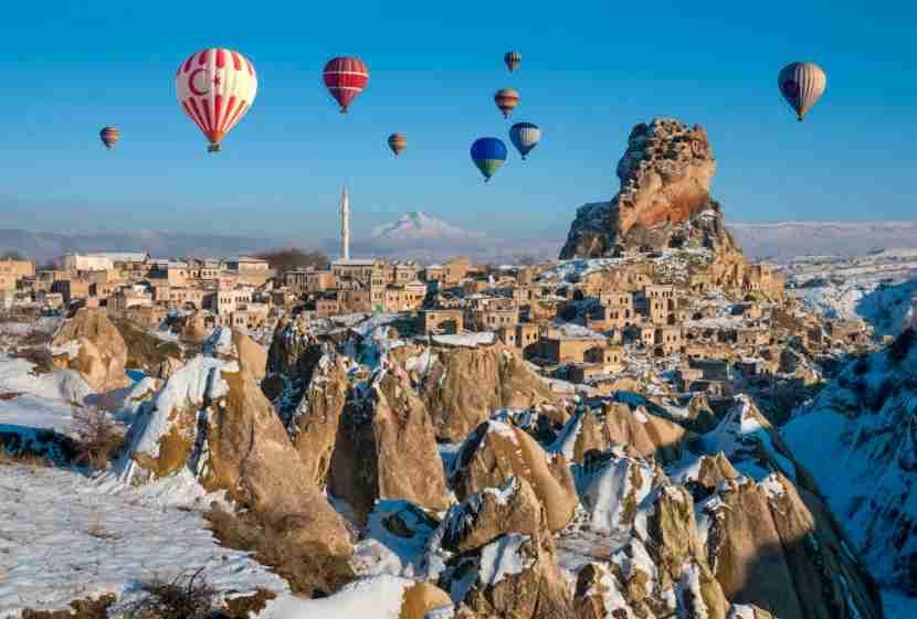 Hot air balloons drift over Cappadocia. Image courtesy of Ayhan Altun via Getty.