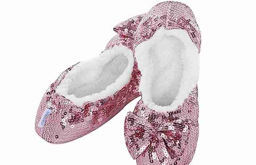 """These glitzy Snoozie slippers are certainly more exciting than your run-of-the-mill hotel slippers. Image courtesy of <a href=""""https://www.amazon.com/Snoozies-Womens-Ballerina-Metallic-Slippers/dp/B00DQUXFS0?th=1"""" target=""""_blank"""">Amazon.com</a>."""