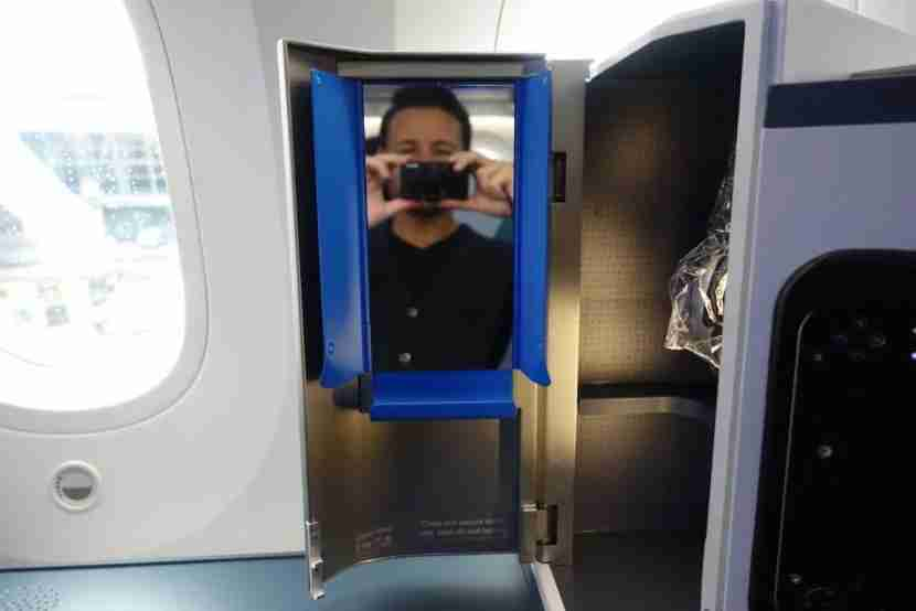 The compartment for small items had a mirror as well.