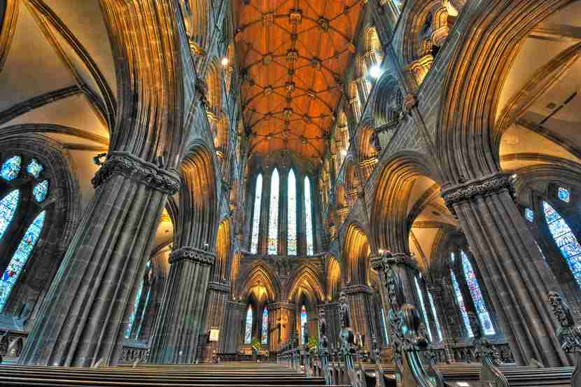"<em>Glasgow Cathedral is the picture-perfect place to duck out of the wintry Scottish weather. Image courtesy of <a href=""http://www.shutterstock.com/pic-107554499/stock-photo-glasgow-scotland-may-7-stone-pillars-pews-and-wooden-vaulting-of-st-mungos-cathedral-on-may-7-2012-in-glasgow.html?src=AV5YfZ7ToOMDbIo-rbh5ZA-1-15"" target=""_blank"">Shutterstock</a>.</em>"