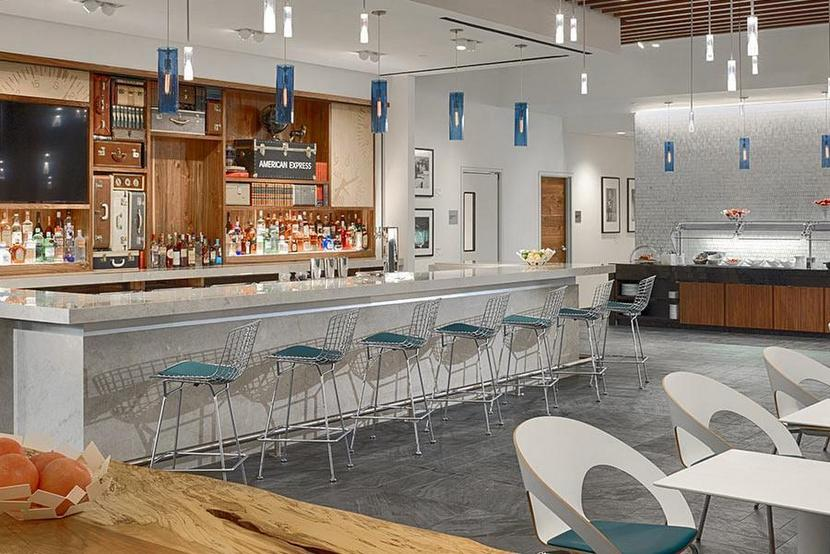 The Amex Platinum card will pay itself off after a few trips to the open bar and buffet like this one at IAH. Image courtesy of Centurion Lounge website.