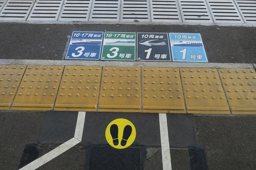 Look for the markings on the floor to see where each car boards.