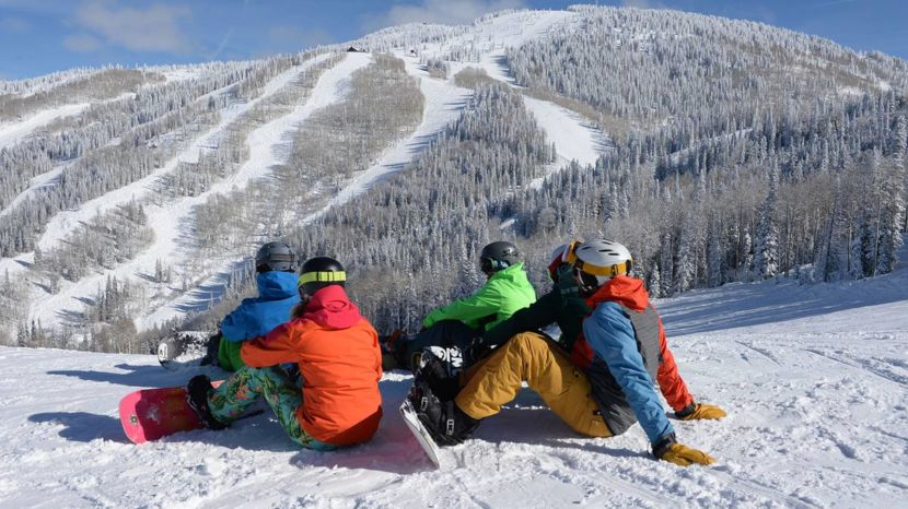 Snowboarders take in the views of Steamboat from the top of a run. Image courtesy of Steamboat Ski Resort.