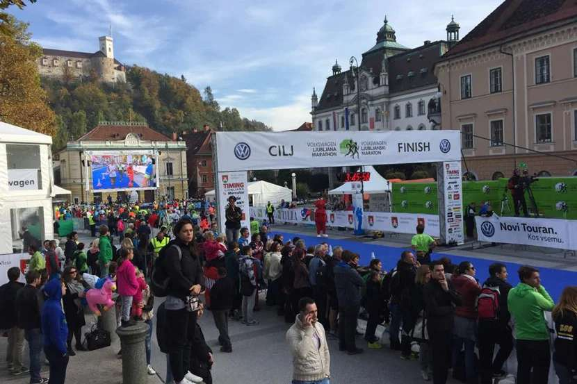 "Runners crossing the Ljubljana Marathon finish line enjoy a view of the castle above. Image courtesy of Ljubljanski maraton's <a href=""https://www.facebook.com/ljmaraton/photos/a.263650887006178.57093.107934602577808/926667840704476/?type=3&amp;theater"" target=""_blank"">Facebook page</a>."