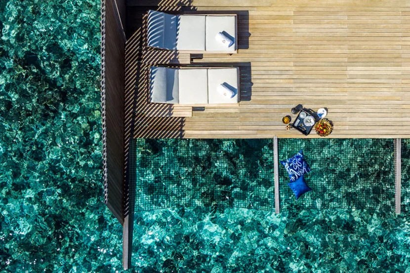 Lap in luxury with butler service straight to your overwater suite at The St. Regis Maldives Vommuli Resort. Image courtesy of the hotel.