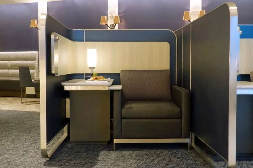 Polaris Lounge guests can enjoy their meals at shared tables or in these private pods.