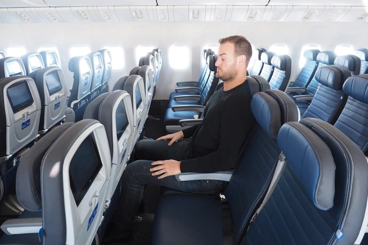 Image result for tall man in an airline seat