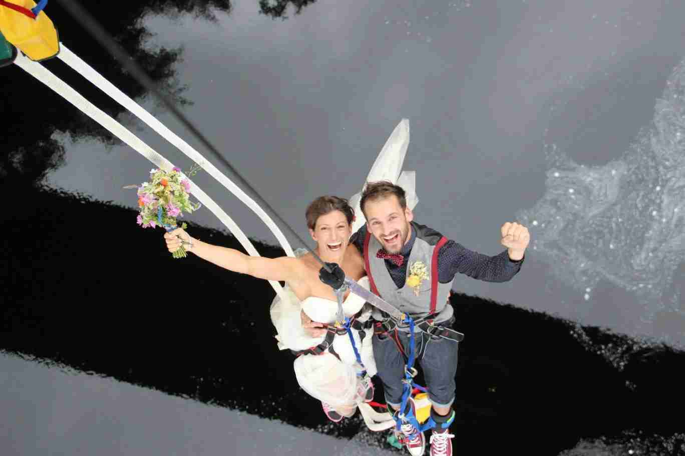 "A happy couple raises their arms in celebration after a successful plunge into marriage — literally and figuratively. Image courtesy of <a href=""https://www.facebook.com/bungeejumpscotland/photos/a.210204508992761.55958.207762905903588/1032447806768423/?type=3&amp;theater"" target=""_blank"">Highland Fling Bungee</a>."