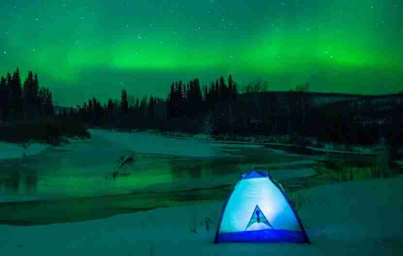 Take in views of the Aurora Borealis along the Chatanika River near Fairbanks, Alaska. Image courtesy of Sherman Hogue/FCVB.