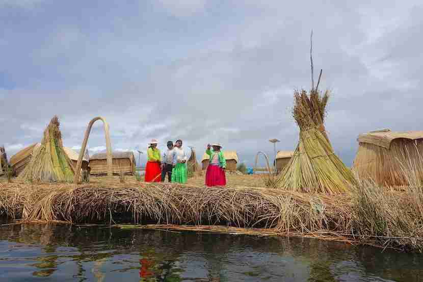 Visit the floating islands of Lake Titicaca.