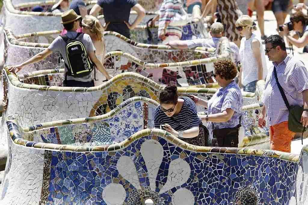 Parc Guell is gorgeous, but crowded. Buy your ticket ahead of time and at dusk to avoid crowds. Image courtesy of Quique Garcia via Getty Images.